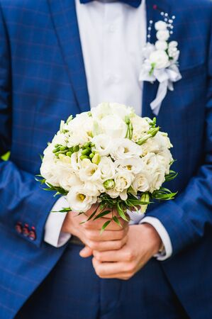 arm bouquet: Groom with wedding bouquet of roses Stock Photo