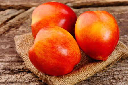 Fresh peaches on the table, delicious, juicy, tasteful