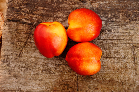 Fresh peaches on the table, delicious, juicy, tasteful,  appetizing, tasty Stock Photo