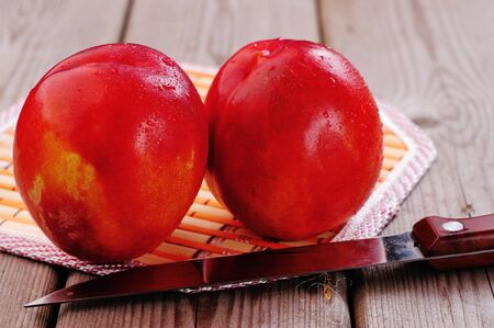 nectarine: peach or nectarine on background wooden table Stock Photo
