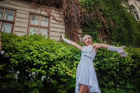 alzando la mano: Portrait of a girl, gestures, emotions, show hands
