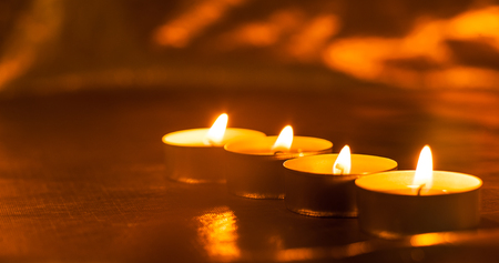Many burning candles.Candle flame light at night
