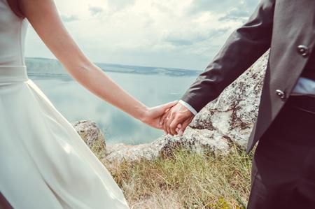 wedding couple.Romantic young couple enjoying sun near river.romance and love by the sea Reklamní fotografie