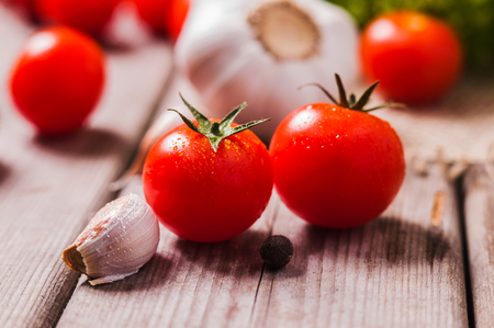 Fresh Tomatoes Closeup shot on wooden table Stock Photo