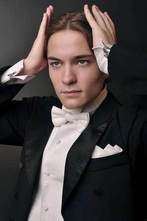 brunete: Elegant young man in suit  Fashion men