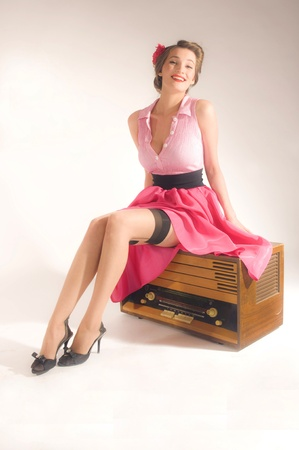 retro radio: Pin-up girl listen retro radio