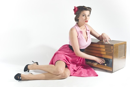 Pin-up girl listen retro radio  Stock Photo - 11333914