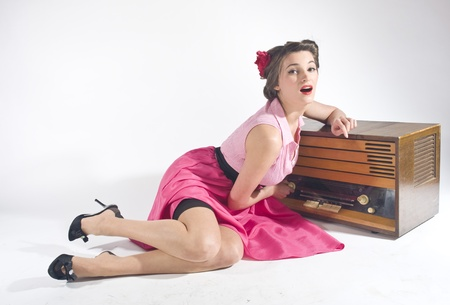 Pin-up girl listen retro radio  Stock Photo - 11333916