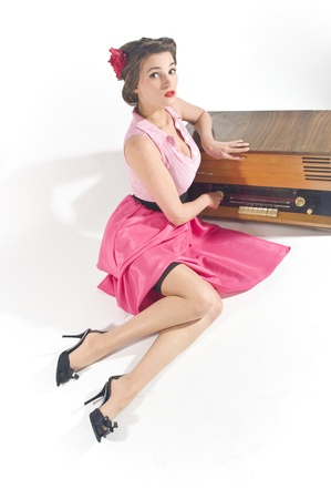 Pin-up girl listen retro radio  Stock Photo - 11333915