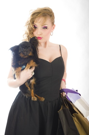 young glamorous blonde with shopping bag holding toy terrier dog Stock Photo - 13171937