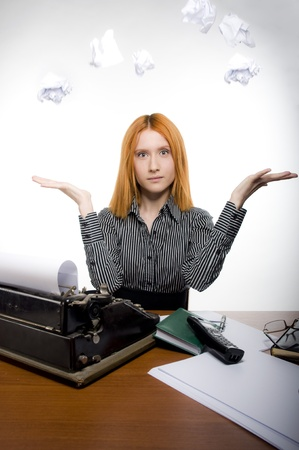 Business women with typewriter and magic paper photo