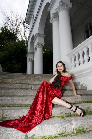 Lady in red dress near private residence  photo