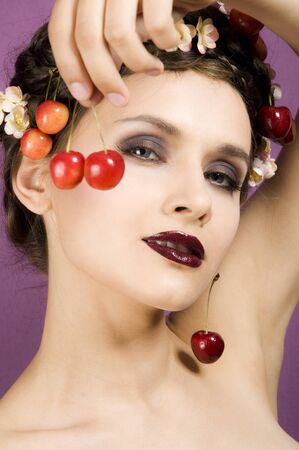 Beauty portrait woman with cherries photo
