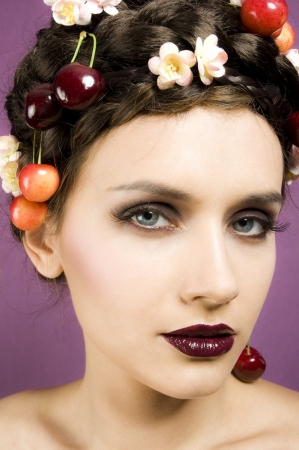 Beauty portrait woman with cherries in hair photo