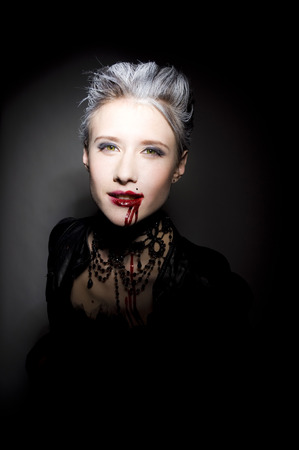 Sexy woman in blood photo