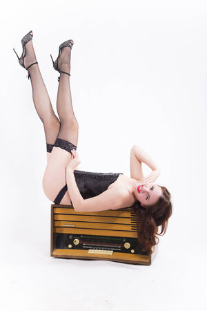 Pin-up girl with retro radio photo
