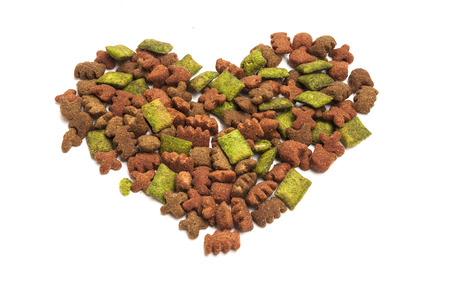 munchy: Dried food for dogpuppy, with a shape of heart isolated