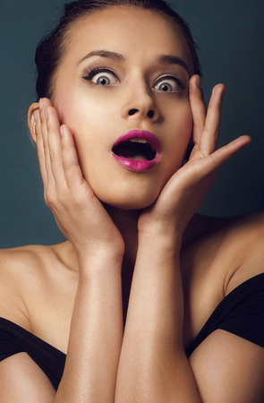 girl mouth open: portrait of surprised beautiful girl in open-mouthed Stock Photo