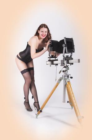 pinup: Pin-up photographer girl Stock Photo