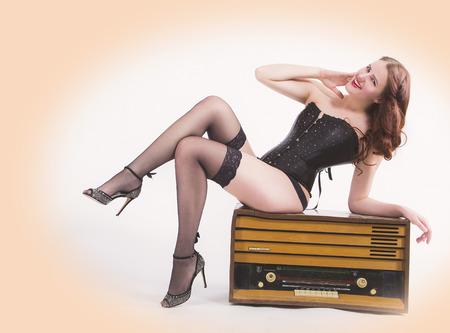 Pin-up girl with retro radio photo