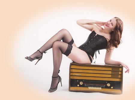 Pin-up girl with retro radio Stock Photo