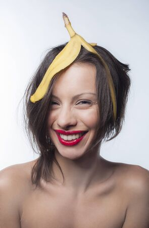 banana skin: Girl with a skin of a banana on his head Stock Photo