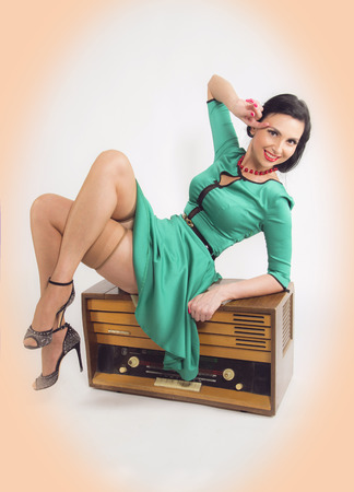 Young pinup women with retro redio photo