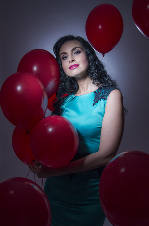 latex woman: Happy young woman with red latex balloons Stock Photo