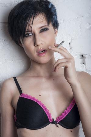 Young woman smoking Stock Photo