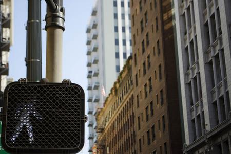 proceed: Walk signal in an urban street setting Stock Photo