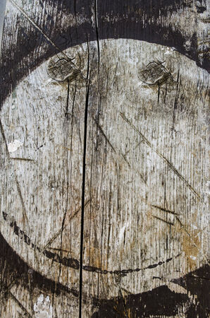 in vain: smiley face wood