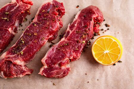 ?eefsteak with peper, spices and lemon, fresh striploin steak, meat dish