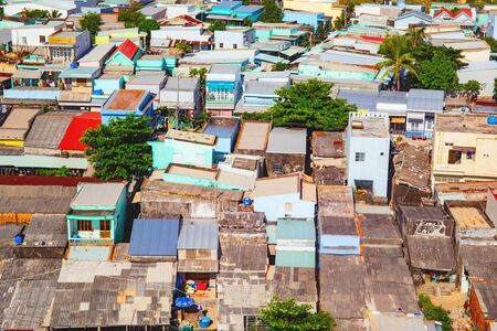Phu Quoc, Vietnam. Slums roofs in a fishing village. Ocean coast landscape with waves, top view.