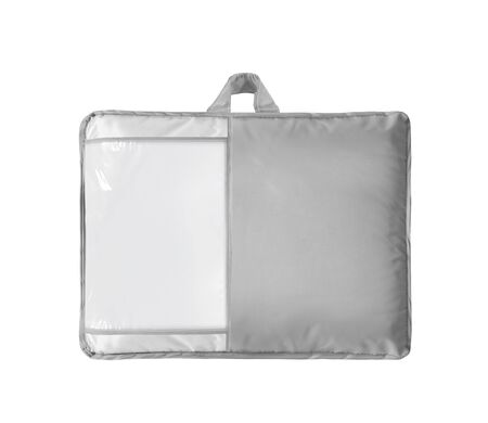 White duvet or bedspread in the bag with empty label isolated. Duvet packed in to the PVC bag against the white background. Front view.