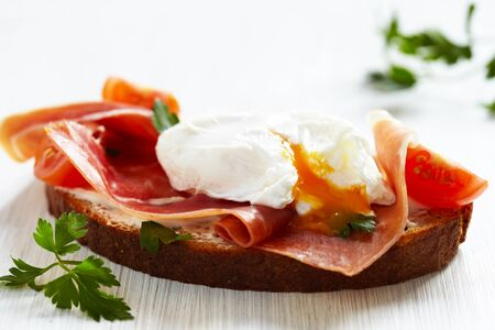 Sandwich with poached egg photo