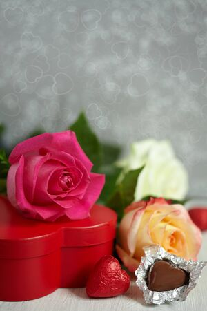Gift box, chocolate and flowers photo
