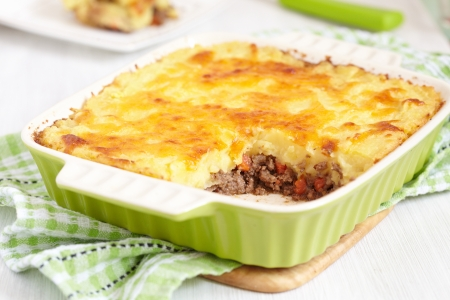 minced beef: Cottage pie in baking dish Stock Photo
