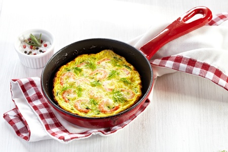 omelette: Omelet with shrimp and zucchini Stock Photo