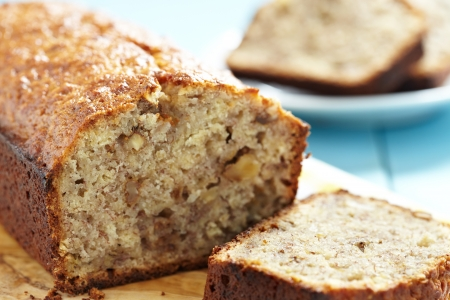 loaf of bread: Sliced banana bread with walnuts