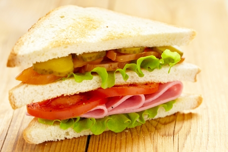 big sandwich with fresh vegetables photo