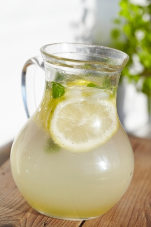 Fresh cold ginger lemonade with ice photo
