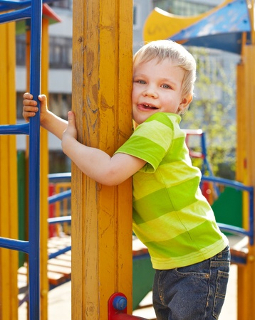 Little boy is playing on playground photo