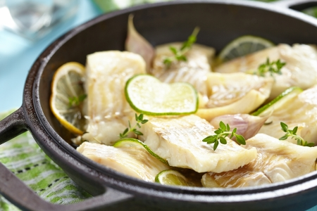 haddock: Baked fish fillet with lemon, lime, garlic and themy