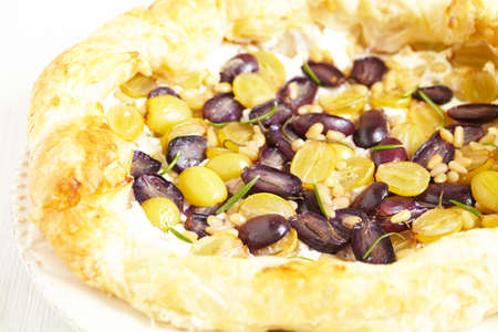 Grape pie with cottage cheese, pine nut and rosemary photo