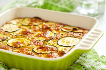 casserole with cheese and zucchini in baking dish Stockfoto