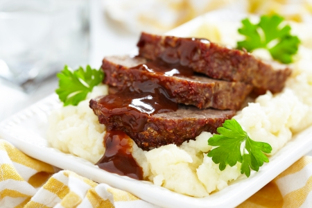 MEAT LOAF: Meatloaf with brown sauce on mashed potato