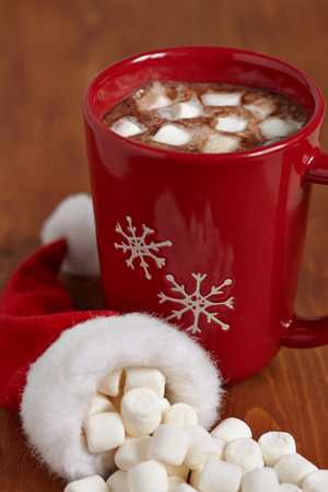 Red mugs with hot chocolate and marshmallows photo