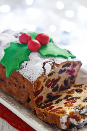 Christmas fruit cake decorated with holly and berries photo