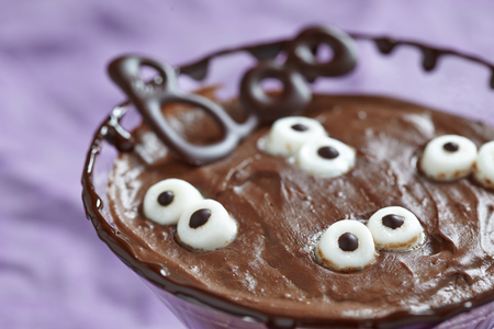 Chocolate pudding with marshmallow for Halloween photo