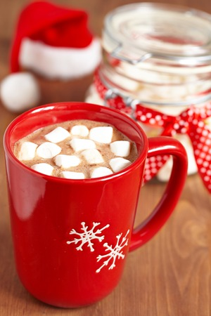 hot chocolate drink: Red mugs with hot chocolate and marshmallows Stock Photo